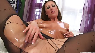 Passionate MaryBeth uses a dildo to please her shaved and wet pussy